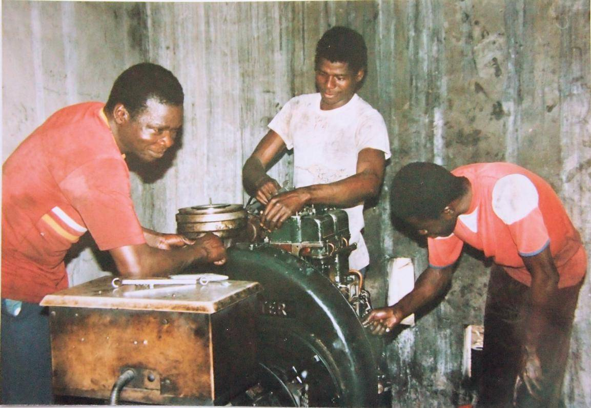 Ghana, Duayaw Nkwanta Hospital: 1986. Servicing a good old HA3 Lister power plant at St. John of God Hospital, Duayaw Nkwanta, Brong-Ahafo Region, Ghana. With HES technicians: Sylvester Akparibo, Emmanuel Atubisah and?