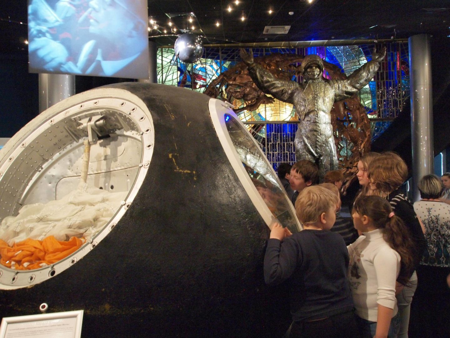 RUS-Moscow Space Exploration Memorial Museum 20130406 Russian kids introduced to space travel watching capsule